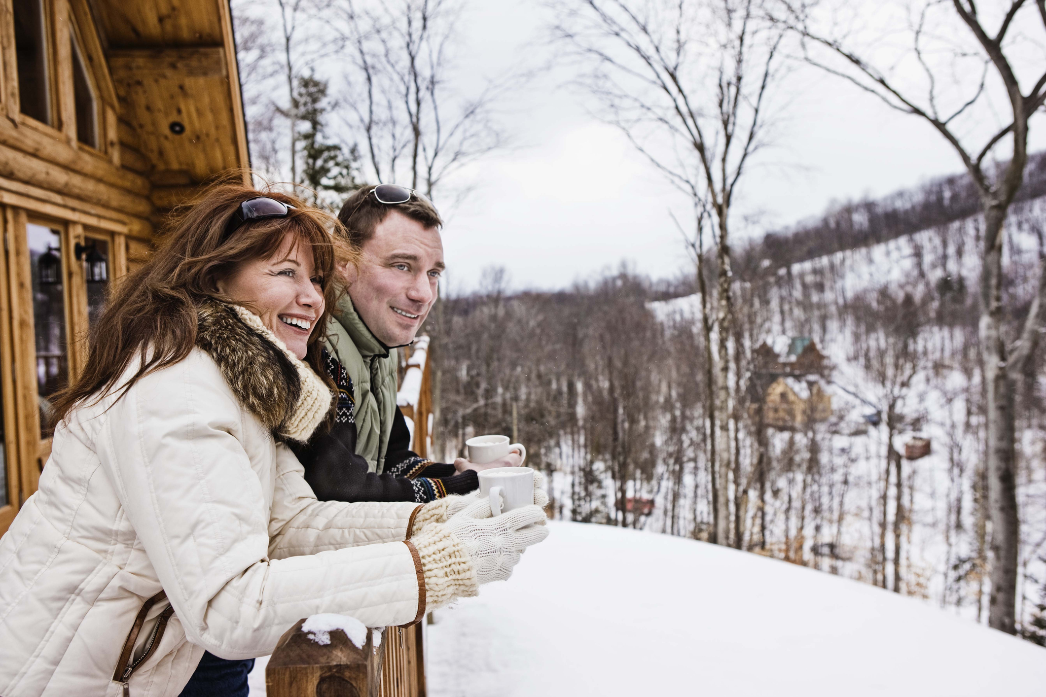 Couple on balcony with hot chocolate